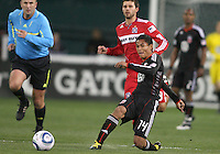 Andy Najar #14 of D.C. United slips a pass ahead of Peter Lowry #8 of the Chicago Fire during an MLS match on April 17 2010, at RFK Stadium in Washington D.C. Fire won the match 2-0.