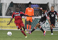 WASHINGTON, DC. - AUGUST 22, 2012:  Andy Najar (14) of DC United knocks the ball away from  Patrick Nyarko (14) of the Chicago Fire during an MLS match at RFK Stadium, in Washington DC,  on August 22. United won 4-2.