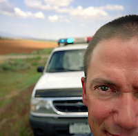 Delores County deputy sheriff Tom Halper patrols a peaceful stretch of U.S. highway 666 in southwestern Colorado. According to Halper, there has been only one fatality on his stretch of the road in 9 years. (Kevin Moloney for the New York Times)
