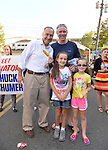 "Bellmore, New York, U.S. 22nd September 2013. U.S. Senator CHARLES ""CHUCK"" SCHUMER  (Democrat), poses with GLEN FARRELL, and his daughters BRIANNA FARRELL, 10, and KEIRA FARRELL, 8,  the 27th Annual Bellmore Festival, featuring family fun with exhibits and attractions in a 25 square block area, with over 120,000 people expected to attend over the weekend. Senator Schumer is running for re-election in November."