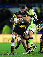 Courtney Lawes of Northampton Saints is tackled by Josh Beaumont of Sale Sharks. Aviva Premiership match, between Northampton Saints and Sale Sharks on December 23, 2016 at Franklin's Gardens in Northampton, England. Photo by: Patrick Khachfe / JMP