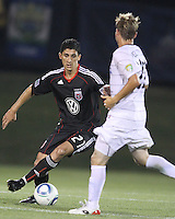Pablo Hernandez #21 of D.C. United  dribbles the ball past Jason Pelletier #22 of the Harrisburg City Islanders during a US Open Cup match at the Maryland Soccerplex on July 21 2010, in Boyds, Maryland. United won 2-0.