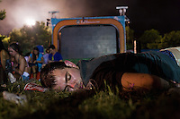 BENIC&Agrave;SSIM, SPAIN - An English tourist lies passed out on the festival site near a screen broadcasting stage acts. ..Described by some as a Mediterranean Glastonbury, the Festival Internacional de Benic&agrave;ssim (FIB) is the largest music festival outside the UK to target British visitors. In 2010, seven of the eight main headline slots were filled by English bands...A small coastal town of 13,000 inhabitants, Benic&agrave;ssim hosted some 200,000 visitors in 2009, with 40% of those believed to be coming from the UK. In 2010, attendances fell to 127,000 visitors but the percentage of UK visitors is believed to have risen.