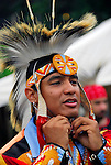 "Portrait of Native American adjusting regalia head piece  Thunderbird Pow-Wow at Queens County Farm Museum. heritage and ethnic pride celebration.... A pow-wow (also powwow or pow wow or pau wau) is a gathering of North America's Native people. The word derives from the Narragansett word powwaw, meaning ""spiritual leader""."