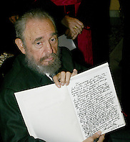 "HAVANA, CUBA: April 4, 2005.- Former Cuban President Fidel Castro signed and show the ""Book of Condolences"" at the headquarters of the Catholic Nunciature in Havana for the death of Pope John Paul II. The Cuban Cardinal Jaime Ortega, who with Pope Francisco helped the restoration of relations between Cuba and the United States. Ortega will leave the leadership of the Catholic Church on the island, said Vatican. . Credit: Jorge Rey/MediaPunch"