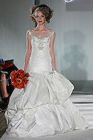 Model walks the runway in a Bianca wedding dress by Katerina Bocci during the Wedding Trendspot Spring 2011 Press Fashion, October 17, 2010.
