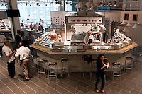 Roma 11 Giugno 2012.Apre Eataly Roma ,nell'ex Terminal Ostiense, quattro piani per una superfice  di 17 mila metri quadri,  ristoranti, caseificio, forno del pane, l'angolo delle fritture,  bar, paninoteche, negozi di alimentari, tutto della migliore qualità italiana. L'angolo delle fritture.Opens Eataly former Roma Terminal Ostiense, four plans for an area of ??17 thousand square meters, ,restaurants, cheese factory, bread oven , the angle fried food, cafes, sandwich shops, food stores, with an emphasis on Italian. The angle fried food