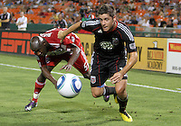 Devon McTavish #18 of D.C. United moves the ball away from Jair Benitez #5 of FC Dallas during an MLS match at RFK Stadium in Washington D.C. on August 14 2010. Dallas won 3-1.