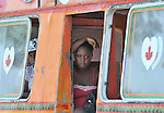 Women are seen riding a bus out of Haiti's capital city, Port-au-Prince, near Leogane, a week after a January 12 earthquake killed tens of thousands and left hundreds of thousands homeless. Capital residents are reportedly fleeing the city in search of safety and better food security in the countryside and smaller towns.