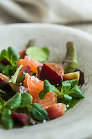 Smoked salmon salad with red beetroots and misticanza
