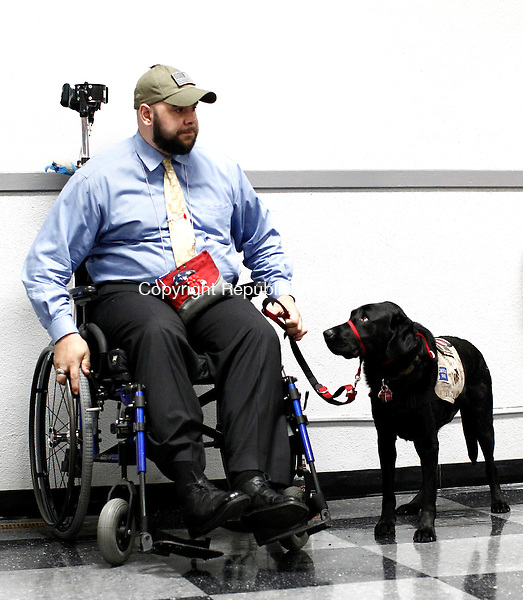 Watertown, CT- 18 May 2014-051814CM10-  Ryan Bugler, a former US Marine listens in to a ceremony with his service dog, Noonan at the Oakville VFW Post 7330 on Sunday.  Bugler who is from Massachusetts, was severely injured while serving in military, acquired a service dog named after US Army Pfc. Gebrah Noonan, a Watertown resident who was killed while serving in Iraq.   Christopher Massa Republican-American