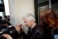Julian Assange, the press trap - 2011<br /> <br /> London, 15/10/2011. St Paul's Square became the stage of the UK arm of the &quot;Occupy&quot; protest movement which has been growing around the world. The Occupy movement is a world-wide protest against the financial crises created by the actual financial system, by speculation, by deregulation, and by the actions of major international financial and investment banks. Around 2,000 protesters armed with tents and placards, gathered outside the famous Cathedral intending to occupy Paternoster Square, home of the London Stock Exchange and the heart of the City of London, but they were hampered by City police officers. After this failed attempt the protesters decided to camp in front St Paul's where the situation with police forces became immediately tense. Masked like the character of Guy Fawkes from the movie &quot;V for Vendetta&quot;, Julian Assange appeared on the square to give a speech in support of the protesters. During the late evening police forces heavily armed with riot control equipment charged the square, attempting to evict the occupants who resisted. Later in the evening the police retreated and the occupation continued peacefully.