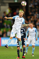 Melbourne, 17 December 2016 - LUKE BRATTAN (26) of Melbourne City jumps for the ball in the round 11 match of the A-League between Melbourne City and Melbourne Victory at AAMI Park, Melbourne, Australia. Victory won 2-1 (Photo Sydney Low / sydlow.com)