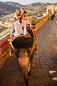 India, Jaipur, tourists riding on elephants up to the Jaipur Fort