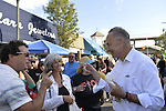 "Bellmore, New York, U.S. 22nd September 2013. U.S. Senator CHARLES ""CHUCK"" SCHUMER  (Democrat), running for re-election in November, makes a campaign visit at the 27th Annual Bellmore Festival, featuring family fun with exhibits and attractions in a 25 square block area, with over 120,000 people expected to attend over the weekend. Sen. Schumer and man smile as they point to each other and talk."