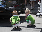 "Two young boys listening to voice coming from a car at the Saugerties Annual ""Car Show"" in Saugerties, NY on Saturday, July 9, 2011. Photo by Jim Peppler. Copyright © Jim Peppler 2011."