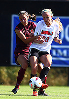 WINSTON-SALEM, NORTH CAROLINA - August 30, 2013:<br />  Casey Whitfield (23) of Louisville University battles for the ball with Danielle King (8) of Virginia Tech during a match at the Wake Forest Invitational tournament at Wake Forest University on August 30. The game ended in a 1-1 tie.