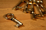 Bunch of antique brass keys on a table