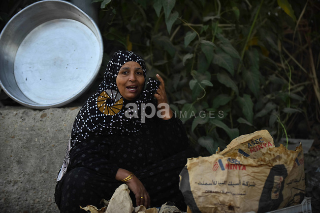 An Egyptian villager sits at her field in Birqash outside of Cairo, Egypt, Sept. 30, 2015. Photo by Amr Sayed