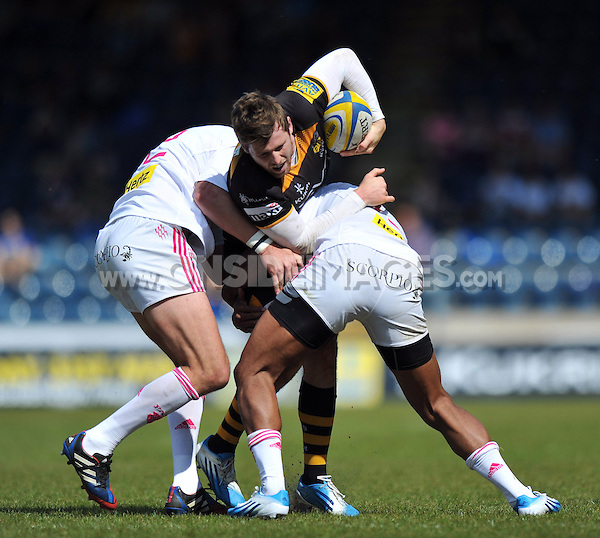 Elliot Daly is double-tackled. European Champions Cup play-off, between London Wasps and Stade Francais on May 18, 2014 at Adams Park in High Wycombe, England. Photo by: Patrick Khachfe / JMP