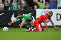 FUSSBALL   1. BUNDESLIGA   SAISON 2011/2012   TESTSPIEL SV Werder Bremen - Olympiakos Piraeus             26.07.2011 Sokratis PAPASTATHOPOULOS (li, Bremen) gegen Djebbour Rafik (re, Piraeus)
