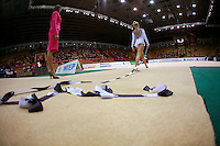 """Hanna-Kristine Bogetveit of Norway walks to carpet with ribbon trailing behind at 2008 World Cup Kiev, """"Deriugina Cup"""" in Kiev, Ukraine on March 22, 2008."""