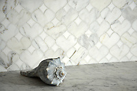 Hearts, a stone mosaic in polished Calacatta Tia and Thassos, is part of the Erin Adams Collection for New Ravenna Mosaics.<br />