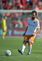 July 28, 2012: Houston Dynamo midfielder Adam Moffat #16 in action during a game between Toronto FC and the Houston Dynamo at BMO Field in Toronto, Ontario Canada..The Houston Dynamo won 2-0.