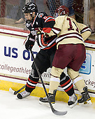Drew Ellement (NU - 2), Pat Mullane (BC - 11) - The Boston College Eagles defeated the visiting Northeastern University Huskies 3-0 after a banner-raising ceremony for BC's 2012 national championship on Saturday, October 20, 2012, at Kelley Rink in Conte Forum in Chestnut Hill, Massachusetts.