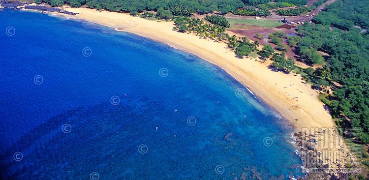 Aerial of the beautiful white sand beach and coastline of Manele Bay on the island of Lanai.