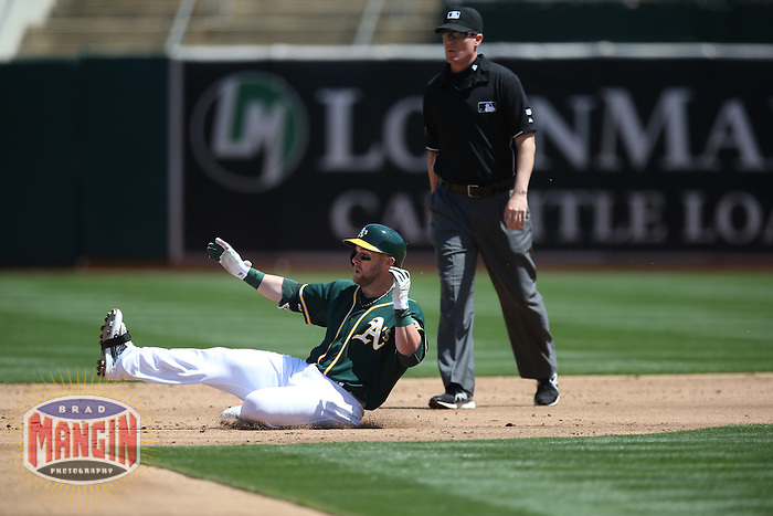 OAKLAND, CA - APRIL 19:  Daric Barton #10 of the Oakland Athletics slides safely into second base against the Houston Astros during the game at O.co Coliseum on Saturday, April 19, 2014 in Oakland, California. Photo by Brad Mangin