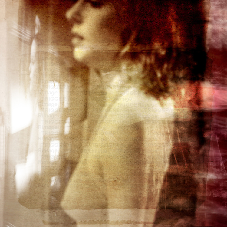 Close up of young woman looking out of window with multiple reflections