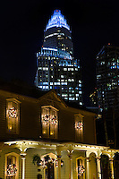 Beautiful Christmas lights illuminate a home  against the backdrop of the Charlotte skyline, at the annual Fourth Ward Holiday Home Tour in Uptown Charlotte, North Carolina. This walkable, self-guided tour allows visitors to get into the Christmas holiday spirit while checking out the beautifully decorated home in Charlotte's historic Fourth Ward.  <br /> <br /> Charlotte Photographer - PatrickSchneiderPhoto.com