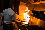 HAVANA, CUBA -- MARCH 22, 2015:   The chef works the stove at Atelier in the Vedado neighborhood of Havana, Cuba on March 22, 2015. Photograph by Michael Nagle