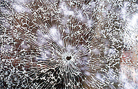 CRACKED SAFETY GLASS<br /> Shattered by small projectile