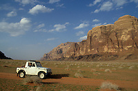 Four wheel drive travelling throughout the desert, Wadi Rum, Jordan.