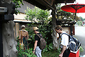 July 20, 2010 - Niiza, Japan - Foreign tourists enters a Buddhist vegetarian restaurant located near Heirinji, Rinzai temple of the Myoshin-ji branch located in Niiza city, Japan, on July 20, 2010. Visiting the temple and taste the buddhist vegetarian cuisine is part of a 'True Japan Saitama' tour, organized by the travel agency JTB for leisure travelers.