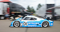 21 June 2009: The #01 Lexus Riley of Scott Pruett and Memo Rojas drives thorught the paddock before  the EMCO Gears Road Racing Classic at Mid-Ohio Spotts Car Course ini Lexington, OH.