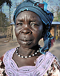 A woman in the Southern Sudan village of Yondoru. Families here are rebuilding their lives after returning from refuge in Uganda in 2006 following the 2005 Comprehensive Peace Agreement between the north and south.