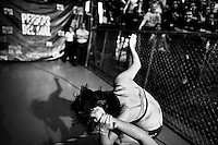 """A female Lucha libre wrestler Keira grabs hair of her rival Sexy Polvora after finishing a fight at Arena Plan Sexenal in Mexico City, Mexico, 29 May 2011. Lucha libre, literally """"free fight"""" in Spanish, is a unique Mexican sporting event and cultural phenomenon. Based on aerial acrobatics, rapid holds and the use of mysterious masks, Lucha libre features the wrestlers as fictional characters (Good vs. Evil). Women wrestlers, known as luchadoras, often wear bright shiny leotards, black pantyhose or other provocative costumes. Given the popularity of Lucha libre in Mexico, many wrestlers have reached the cult status, showing up in movies or TV shows. However, almost all female fighters are amateur part-time wrestlers or housewives. Passing through the dirty remote areas in the peripheries, listening to the obscene screams from the mainly male audience, these no-name luchadoras fight straight on the street and charge about 10 US dollars for a show. Still, most of the young luchadoras train hard and wrestle virtually anywhere dreaming to escape from the poverty and to become a star worshipped by the modern Mexican society."""