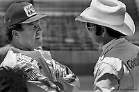 INDIANAPOLIS, IN: AJ Foyt (left) speaks with Mike Mosley during practice for the Indianapolis 500 on May 29, 1977, at the Indianapolis Motor Speedway.