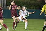 10 November 2013: Florida State's Berglind Thorvaldsdottir (ISL) and Virginia Tech's Jordan Coburn (19). The Florida State University Seminoles played the Virginia Tech Hokies at WakeMed Stadium in Cary, North Carolina in a 2013 NCAA Division I Women's Soccer match and the championship game of the Atlantic Coast Conference tournament. Florida State won the game 1-0.
