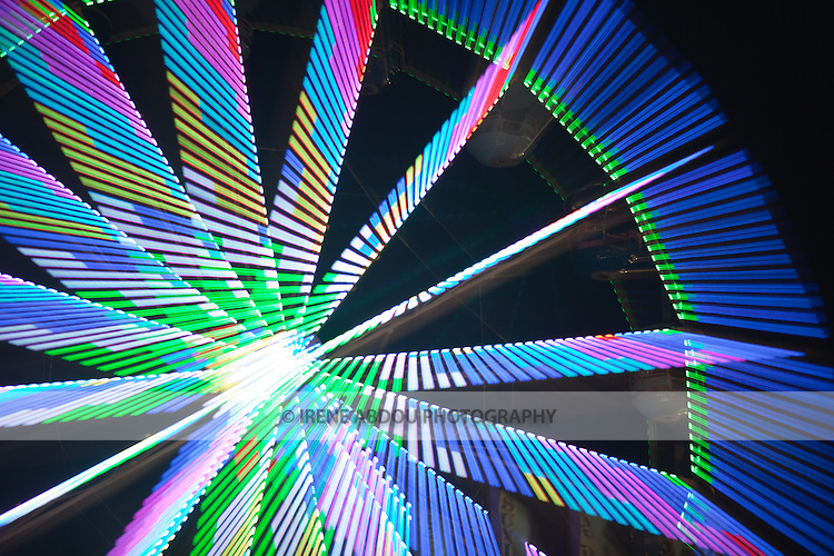 """A photography technique called """"zoom blur"""" is used to transform the lights of the ferris wheel into abstract designs at the Montgomery County Agricultural Fair in Gaithersburg, Maryland."""