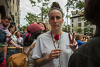 NEW YORK JUNE 13: One of the assistants at the vigil for the victims of Orlando shooting holds a rose near to the Stonewall Inn, a historic New York City gay bar were thousands expressed their support for the victims. New York June 13,2016<br />  Photo by VIEWpress/Maite H. Mateo.