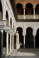 Low angle view of the Central Patio with a Roman statue of Minerva in the distance, Casa de Pilatos (Pilate's House), Seville, Spain, pictured on December 30, 2006, in the afternoon. Pilate's House, late 15th century, was built by the Enriquez and Ribera families During the 16th century these families, who had a strong relationship with Italy,  introduced the Renaissance style to Seville. In the palace is the sculpture collection of the Duke of Alcala  who brought back many Classical pieces from Italy and adapted the palace and gardens to exhibiting them in Renaissance style. The buildings were further modified according to Romantic taste in the 19th century and now present a combination of Mudejar-Gothic, Renaissance and Romantic styles. Today the Casa de Pilatos belongs to the Fundacion Casa Ducal de Medicaneli and is the residence of the Dukes of Medicaneli. Picture by Manuel Cohen.