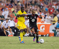 Maicon Santos (29) of D.C. United fights for the ball with Tony Tchani (6) of the Columbus Crew during the game at RFK Stadium in Washington, DC.  D.C. United defeated the Columbus Crew, 1-0.