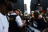 Chicago Police torture victim Mark Clements discusses with police before leading a march from Federal Plaza to support a Citizens Police Accountability Council to provide civilian oversight of the Chicago Police Department in Chicago, Illinois on July 11, 2016.  The demonstration attracted a larger crowd on the heels of last week's racially charged police shootings captured on video of Alton Sterling in Baton Rouge, Louisiana and Philando Castile in the St. Paul suburb of Falcon Heights, Minnesota which was followed by a mass shooting of five police officers by Afghan War veteran Micah Johnson who supported radical and violent black nationalist ideology.