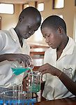 Mary Alual Adeel (left) and Rose Arual Deng work together on an experiment in the chemistry lab at the Loreto Secondary School in Rumbek, South Sudan. The school is run by the Institute for the Blessed Virgin Mary--the Loreto Sisters--of Ireland.