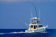 sport fishing boat with Hawaiian Green Stick tuna rig, Kona Coast, Big Island, Hawaii, USA, Pacific Ocean