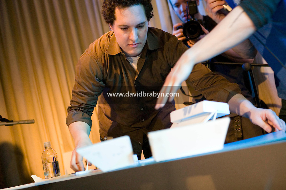 21 March 2006 - New York City, NY - Architects Amador Pons (L) moves the model he designed with his colleague (hidden) as they compete in Architecture Duel, a timed architectural competition organised by the creative group, the LVHRD Foundation, in New York City, USA, 21 March 2006. The duel was won by the 2-person firm Grzywinski-Pons. Arquitectonica is a +400 person firm with offices around the world.